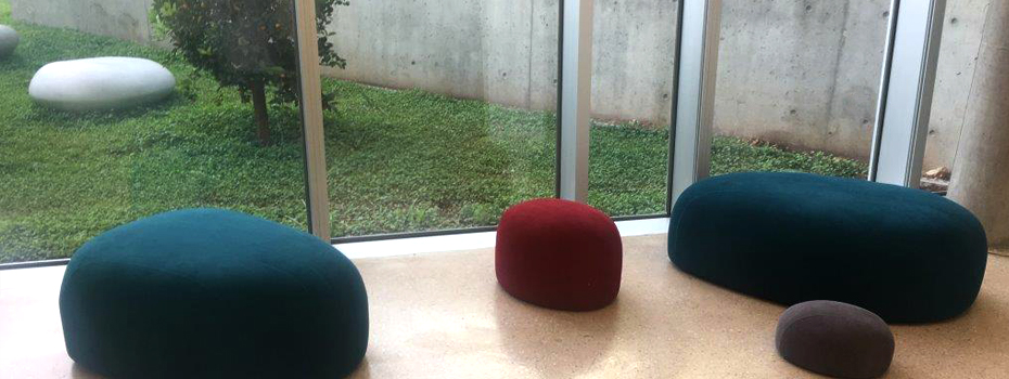 Byblos Library's Furnishing: Pebbles furniture mirroring the exterior's stone pebbles.