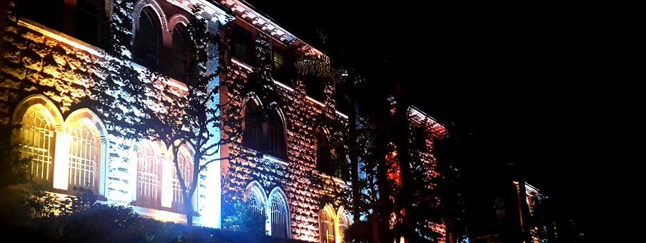 Sage Hall's lights coloring Beirut campus at night