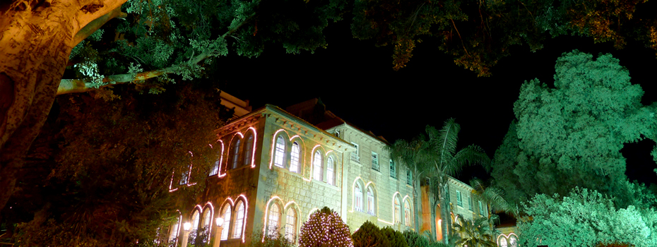 Sage Hall and Beirut campus all lit and contrasting the evening's darkness.